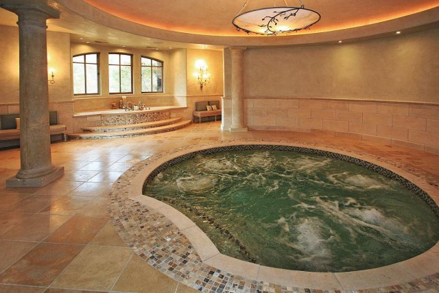 If you need another place to relax, there's this 12-person jacuzzi, in addition to several other soaking tubs.