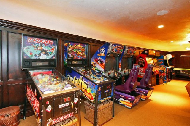A wide selection of arcade games lines the wall.