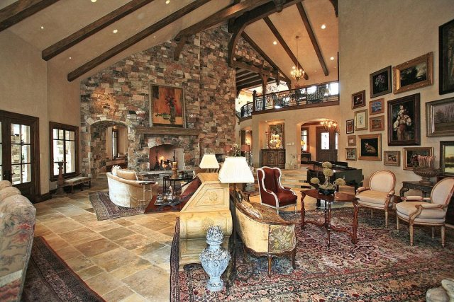 There's a ton of art lining the walls, and another limestone fireplace dominates the opposite side of the same room.