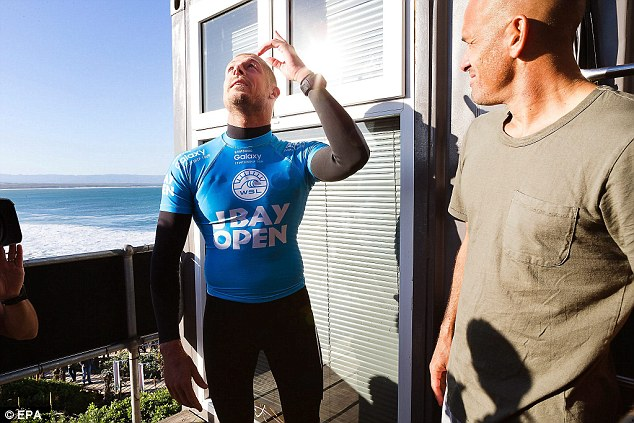 Fanning looks to the skies as he recalls the moment he was almost bitten by a shark (right with him is fellow champion Kelly Slater)
