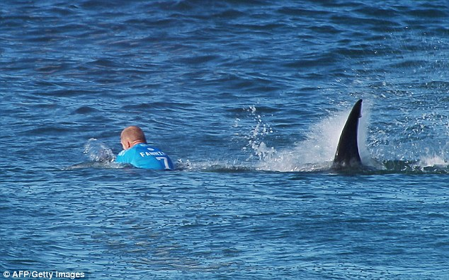 Amazing footage of Australian surfing legend Mick Fanning fighting off a shark was captured on camera