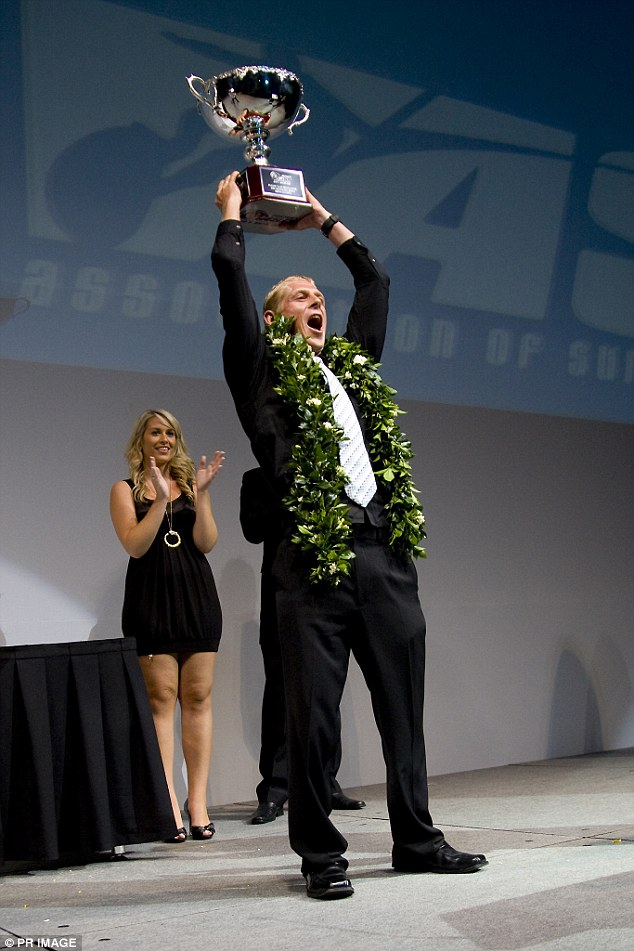 ASP World Champion Mick Fanning after he was presented with his official ASP World Title trophy at ASP World Champions Crowning Ceremony at the Gold Coast in 2008