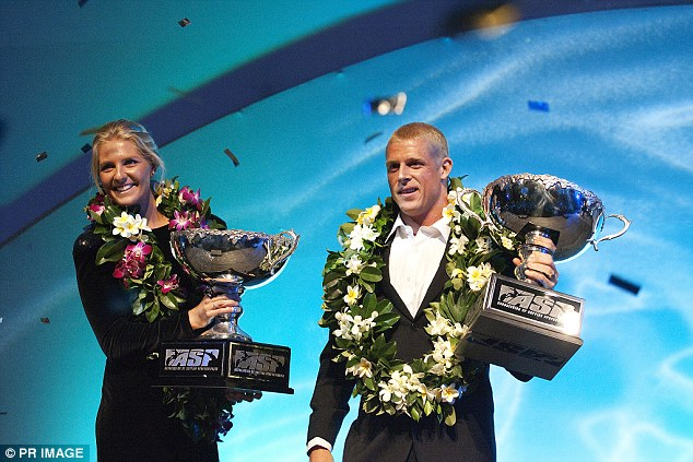 2009 ASP World Champions Stephanie Gilmore from Tweed Heads (left) and Mick Fanning, also from Tweed Heads, pose after receiving their ASP World Title Trophies