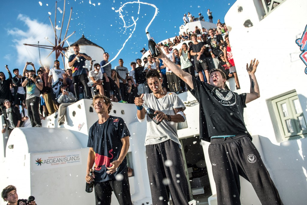"Pavel Petkuns of Latvia, Dimitris Kyrsanidis of Greece (winner) and Jesse Peveril of Canada celebrate during the award ceremony of ""Red Bull Art of Motion"" freeruning competition in Santorini Island, Greece on October 3, 2015."